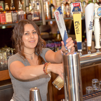 Woman poring a draft beer